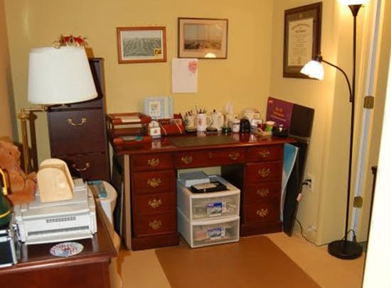 After – Extra supplies were purged and sorted to fit in the office closet and new lighting was added to brighten the space.